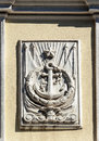 Bas-relief of ship's anchor on the old wall Royalty Free Stock Photo
