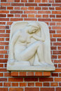 Bas-relief The squating girl & x28;Genius& x29;, a close up. Kaliningrad Royalty Free Stock Photo
