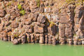 Basalt rock columns of miles canyon yukon canada close up weathered geologic cliff wall with water river territory Stock Photography