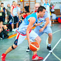 Bascketball players performs at the Sport Arena Stock Photo