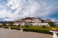 Base potala palace sidewalk front lhasa tibet a cloudy sky looms over the immense seen from the in china Stock Images