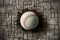 Baseball ball embedded in a brick wall Stock Photography