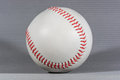 Baseball ball over gray background horizontal shot with shallow focus and creative lighting Stock Photos