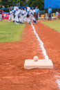 Baseball and base on baseball field with players and judges Royalty Free Stock Photo