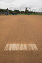 Baseball base on a field on a cloudy day Stock Images