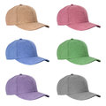 Baseball caps in different colours on isolated background Stock Image