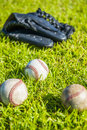 Baseball on the field with green grass Royalty Free Stock Images