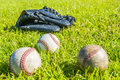 Baseball on the field with green grass Stock Image