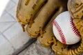 Baseball game mitt and ball on home plate / base Royalty Free Stock Photo