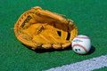 Baseball glove and ball on the field zagreb croatia august official major league green product shot Royalty Free Stock Photography
