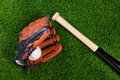 Baseball glove bat and ball on grass Royalty Free Stock Photography