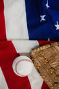 Baseball and gloves on an American flag Royalty Free Stock Photo