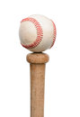 Baseball on knob of bat a used resting the end a wood vertical format isolated white Stock Images