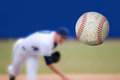 Baseball pitcher a throwing a strike selective focus on the ball coming into close view horizontal composition copy space Royalty Free Stock Photo