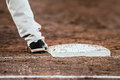 Baseball player with he's feet touching the base plate Royalty Free Stock Photo