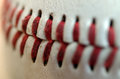 Baseball seams macro close up of the blood red of a regulation Royalty Free Stock Photo