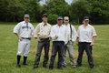 Baseball team in 19th century vintage uniform during old style base ball play following the rules and customs from 1864 Royalty Free Stock Photo