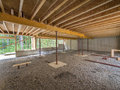 Basement construction under a new house showing joists and gravel floor Royalty Free Stock Photo