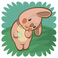 Bashful bunny with a flower in paws Stock Images