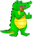 Cute baby crocodile thumb up and holding chicken thighs Royalty Free Stock Photo