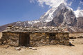Basic stone cabin and mountain along everest base camp trail nepal Royalty Free Stock Photos