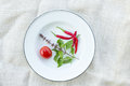 Basil chili and tomato on white fabric background Royalty Free Stock Photo