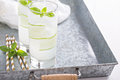 Basil cucumber sparkling drink in tall glasses Royalty Free Stock Photo