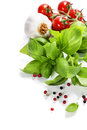 Basil and fresh vegetables leaves on white background Stock Photos
