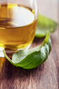 Basil leaves and olive oil Royalty Free Stock Images