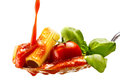 Basil pasta and tomato sauce on an isolated background Stock Photo