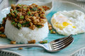 Basil rice with pork and fried egg Stock Photography