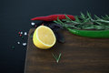 Basilic, rosemary, red and green chili pepper, half a lemon and Royalty Free Stock Photo