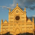 Basilica di santa croce facade of of holy cross illuminated by golden sunset light in florence Stock Image