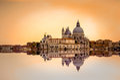 Basilica di Santa Maria della Salute reflected on the water surface, Venice, Italy. Royalty Free Stock Photo