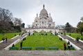 Basilique du sacre coeur paris france march tourists at montmartre gardens on march in france Stock Photography