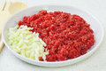 Basis many family meals quality raw minced beef chopped onion bowl granite surface Royalty Free Stock Photography