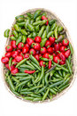 Basket of assorted peppers on display Stock Image