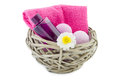 Basket with bath foam and bath bombs filled pink isolated on white Royalty Free Stock Photography