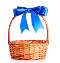 Basket with a blue bow Royalty Free Stock Image