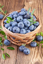 Basket of blueberries on a wooden background Stock Photography