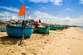 Basket boats idle on the beach at Phuoc Hai village, Ba Ria Vung Tau province, Vietnam Royalty Free Stock Photo