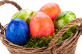 Basket of brightly coloured Easter Eggs Royalty Free Stock Photo