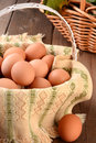 Basket of brown eggs closeup a full in a rustic farmhouse like setting horizontal format with shallow depth field Royalty Free Stock Photography
