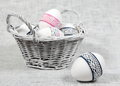 Basket decorated easter eggs one egg close Stock Images