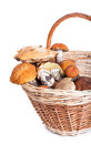 Basket with different mushrooms from forest closeup on white background Royalty Free Stock Images