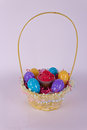 Basket with Easter eggs and cupcake Royalty Free Stock Photos