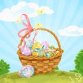 Basket with easter eggs on the lawn green Royalty Free Stock Photos