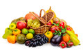Basket with fresh fruits and vegetables isolated on a white back Royalty Free Stock Photo