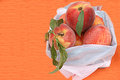 Basket of fresh peaches filled with at outdoor market Stock Photo