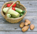 Basket with fresh vegetables on a wooden table Stock Photography